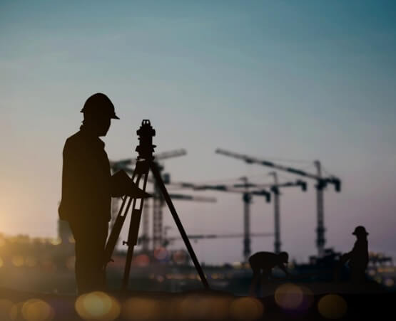 The silhouette of a civil engineering performing Land Surveying in Springfield IL