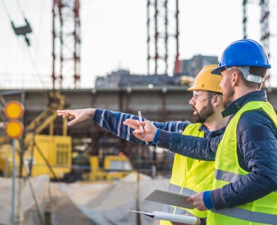 Contractors on a construction site performing ALTA Surveys in Peoria IL